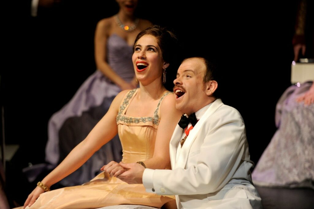 Lucia Cesaroni (Adele) and Gregory Finney (Cesaroni) in Toronto Operetta Theatre's Die Fledermaus. Photo: Gary Beechey