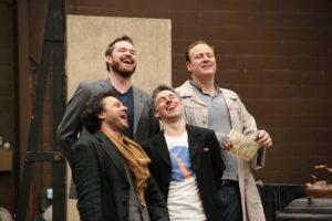 Cast of La Bohème in rehearsal